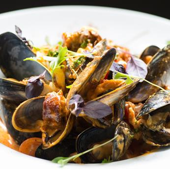 Mussels with chorizo, cider, tomato and sage