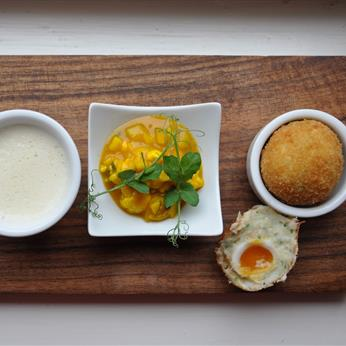 Smoked haddock scotch egg with pub piccalilli & malted parsnip milk